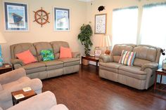 Living room has 6 recliners for relaxing after a day at the beach.  See our page at https://www.facebook.com/barefootescapebeachrental/
