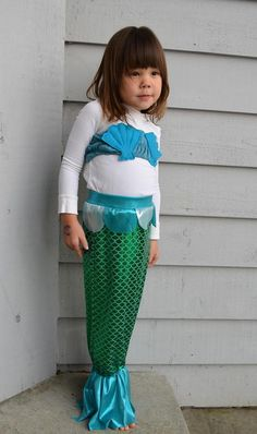 Homemade Mermaid Costume - Your little girl will love dressing up for Halloween in this Homemade Mermaid Costume. The tail is easy to walk in, turns into a cute skirt and this pattern also has a bandeau shell top. She'll never want to take off this homemade Halloween costume.