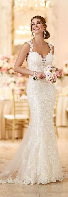 Stella York long lace wedding dress with beads. Beautiful. I also like the colour of the bouquet - pastel pink, cream and green go really well with this dress to provide an elegant touch. #laceweddingdresses