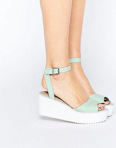 b10ffb2129dbff A pair of flat wedge sandals.  WedgeSandals Sock Shoes
