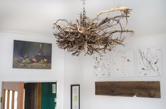 """Lovely found root ball hung as a """"chandelier"""" in the main entranceway Chandelier, Restaurant, Ceiling Lights, Vegan, Interior Design, Home Decor, Twist Restaurant, Nest Design, Homemade Home Decor"""