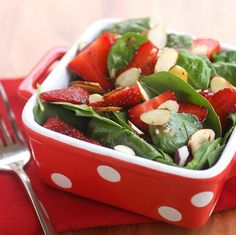 Strawberry Spinach Salad with almonds  http://www.the-girl-who-ate-everything.com/2011/03/strawberry-spinach-salad.html