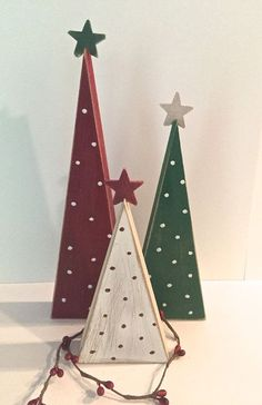 This set of wooden Christmas trees is a perfect addition to your holiday decor! This listing is for the set of 3 trees. a 9, 7, and 5 tree will come in this set. The trees are painted red, green and white with polka dots.