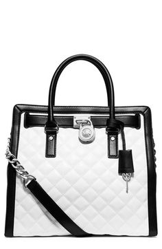 Free shipping and returns on MICHAEL Michael Kors 'Hamilton' Quilted Lambskin Satchel at Nordstrom.com. Vintage handbag designs inspire the belted trim and squared silhouette of this diamond-quilted leather satchel. The iconic bag's crisp black-and-white palette makes it easy to pair with any ensemble, while the logo-engraved padlock and chain-detailed strap provide elegant polish.