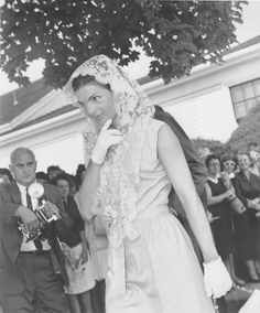 Jackie leaving Mass: A simple sleeveless dress, a lace mantilla covering the head, and wrist length gloves revolutionized the churchgoing wardrobe of American Catholic women in the early 1960s.