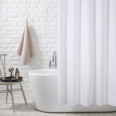 modern bathroom with white painted brick, freestanding bathtub, and white shower curtain. Trending in Bathroom Decor: Airy, White Shower Curtains from Bathroom Bliss by Rotator Rod Extra Long Shower Curtain, Long Shower Curtains, Striped Shower Curtains, Shower Curtain Hooks, Bathroom Shower Curtains, Fabric Shower Curtains, Curtains Uk, Curtain Fabric