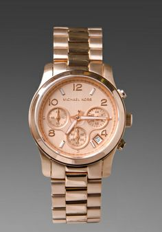 Thanks to my awesome brother-in-law I am now a very excited owner of this MICHAEL KORS watch!  Thanks little brother for the awesome christmas present
