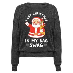 "Get sassy this Christmas with this meme Santa shirt. This tee features an illustration of Santa and the phrase ""I Got Christmas In My Bag Swag."""
