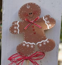 Decorate your plant pots (indoor or outdoor) with this adorable Gingerbread Boy plant stick. His bowtie is red ribbon edged with silver. He is cut from 1/2 baltic birch and attached to a 13 long x 1/4 dowel, with wood glue. Gingerbread measures 4 1/4 tall and 4 wide. Red raffia bow is tied on dowel