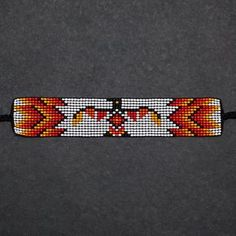These beaded bracelets were designed and hand-loomed by crafter Charlotte Deavall. Charlotte is Anishinaabe from Winnipeg, Manitoba. She is from the Algonquin Ojibwe peoples. Learning from her Mom at a young age, she continues the tradition of loom beading. Inspired by her cultural heritage