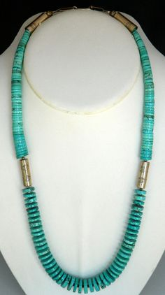 This is a beautiful Santo Domingo graduated turquoise and sterling silver bead necklace made by Dorothy Coriz. This necklace was purchase in