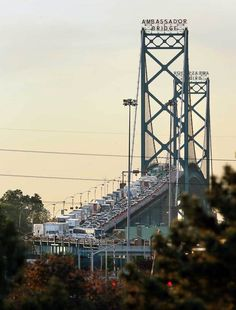 Ambassador Bridge Detroit MI to Windsor Canada. Due to 911 now you have to sit while every other car gets attacked by homeland security. Why are we stealing there maple syrup ?
