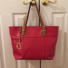 """Lauren Ralph Lauren Red Leather Tote w/Tan Handles Amazing bag for work! Gorgeous Lauren Ralph Lauren Red soft leather tote bag with tan handles, gold hardware, and plenty of interior space. One exterior pocket, one large interior pocket w/snap, one medium interior pocket w/snap, and two smaller interior pockets. Zip top closure. Large interior can fit 13"""" slim laptop (11x16x7). Gently used a few times w/a few small signs of wear on bottom (pictured) and a few small spots and slight…"""