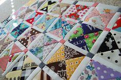 Scrap quilt beautifully set
