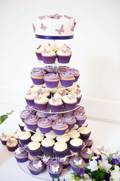 midnight in paris  cake | Purple and Ivory wedding cupcake tower with butterflies and piped ...