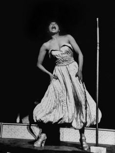 """""""Swishing her pantalooned gown, she crossed her eyes exuberantly, brought cheers from the packed theater as she shouted, 'You make me so hop-py! Josephine Baker, Scott And Zelda Fitzgerald, Billie Holiday, Life Pictures, Strapless Dress Formal, Bring It On, Gown, Cheers, Theater"""