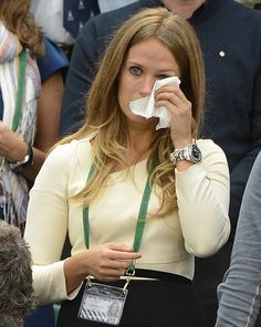 Kim can't hide her emotions and eventually pulls out a tissue to wipe away the tears after her long-term partner lost to Roger Federer