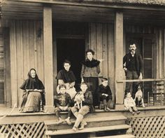 Family on the porch of a house in Sand Mountain, a community in Bibb County, Alabama. :: Alabama Photographs and Pictures Collection