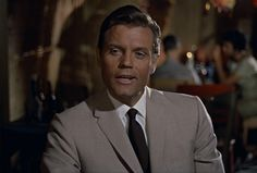 Felix Leiter sure knew how to classically rock a beige, would you wear it that way or would you add a bit of color with a different tie?