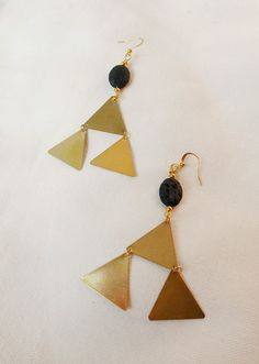 Dangling lava earrings raw brass triangle by ArtandMagictoWear, €20.00