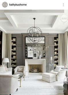 elegant classic living area. What dominates the room? the bookshelf. The curtains add a little mystery to them. Nice.
