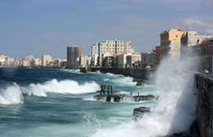 Waves pound El Malecon, a seawall and roadway in Havana, Cuba on March 22nd, 2009. (Neiljs / CC BY-SA)