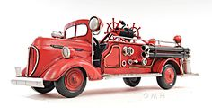 """CaptJimsCargo - 1938 Ford Fire Engine Truck Metal Desk Car Model 14"""" Automobile Decor,  (http://www.captjimscargo.com/metal-model-tether-cars-automobiles/1938-ford-fire-engine-truck-metal-desk-car-model-14-automobile-decor/) This model is the manufacturer's artistic interpretation of a 1938 Ford Fire Engine truck and so some details are not entirely correct."""