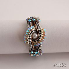 Gorgeous colors by shilabead...pattern in Feb/Mar 2012 Beadwork