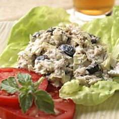ARTICHOKE & OLIVE TUNA SALAD - Ingredients: 1 can (12-ounce can or two 6-ounce cans) chunk light tuna drained and flaked, 1 cup chopped canned artichoke hearts, 1/2 cup chopped olives, 1/3 cup reduced-fat mayonnaise (or another substitute), 2 teaspoons lemon juice, 1 1/2 teaspoon(s) chopped fresh oregano or 1/2 teaspoon dried - Serves 5 (about 3/4 cup per serving)