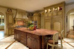 Italian Renaissance kitchen designed by Tracy Rasor, Dallas Design Group Interiors, and built by Sharif and Munir Custom Homes.