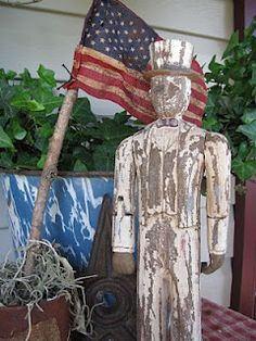"Old Distressed ""Uncle Sam""...with a flag."