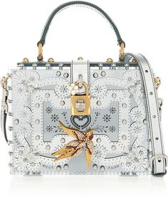 Dolce & Gabbana Mirrored-Plexiglas Shoulder Bag. Dolce & Gabbana's exquisite shoulder bag is inspired by traditional Venetian mirrors. Handcrafted in Venice from mirrored-Plexiglas, it's lavishly embellished with gold flower and bird plaques, twinkling red Swarovski crystals and lustrous faux pearls. $9,795