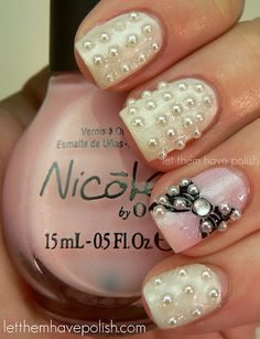 all the pearls are a bit excessive for me, but i would do the one nail with the bow & pearls!