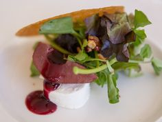 Meet Paramour's Poached Pear & Goat Cheese #Salad with Port Poached Seckel Pear, Shellbark Hollow #1 Chèvre, Petite Greens, and Candied Walnut Vinaigrette