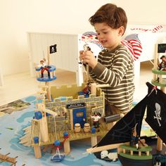Pirates & Buccaneers Toy Fort - This lovely, wooden toy will inspire hours of creative play, thanks to all the elaborate piratey details!  Team it up with our Toy Pirate Ship and our Toy Pirate Sets for maximum fun.