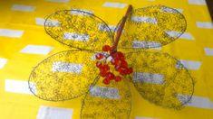 Rautalangasta kukan terälehdet ja punaisista helmistä keskusta