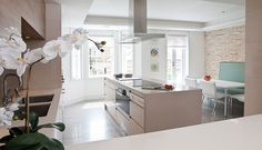 Colors and design of this kitchen remind me of a kitchen I designed as an undergrad. Love the simplistic finishes.