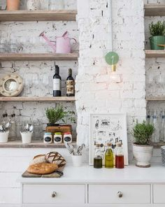 dream kitchen: Hally's Parsons Green, open storage wood shelves against painted white brick walls