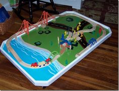 DIY Train Table - top only on wheels so it can slide under the bed!