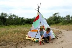 Lookie what she made: Kid's teepee from old shirts Slumber party ideas decorations games , crafts and activities.