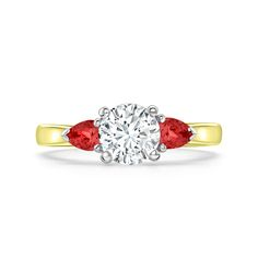 The 'Grafton' is a classic engagement ring. It is part of Heming's exclusive 1745 Collection, designed in-house & manufactured in our London workshops. The principal diamond is held in a four claw setting on a 2.5mm comfort fit band, complete with pear shaped ruby shoulders, combined weight 0.15-0.40ct. The Grafton range also includes a diamond set eternity ring and wedding band, bespoke designed to be worn alongside one another. Diamond Solitaire Rings, Diamond Wedding Rings, Wedding Bands, Classic Engagement Rings, Eternity Ring, Heart Ring, Jewels, Pear Shaped, Bespoke