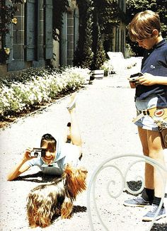 Audrey Hepburn. Clicking. Sean looking down. Assam, the dog, looking up.