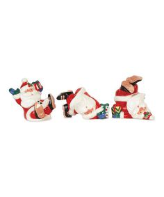 Take a look at this merry amp bright tumbling santa figurine set by fitz