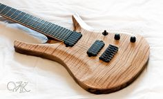 This is the Duality-7 by Vik Guitars. I believe this is now become the Nolly GetGood (Red Seas Fire) Signature guitar? It sounds amazing. If you haven't heard of Red Seas Fire, check them out.