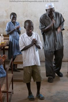 Pupils and the Deputy Head Teacher perform for visitors at Makumbaya Lower Basic School in Makumbaya Village, The Gambia, West Africa. http://buildingfuturesinthegambia.com/