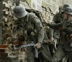 Wehrmacht troops in a street battle some time after (No Information) # German Soldiers Ww2, German Army, Ww2 German, Military Art, Military History, Military Diorama, Pin Ups Vintage, Germany Ww2