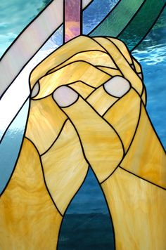 Stock Photo Praying Hands On Stained Glass In The Church