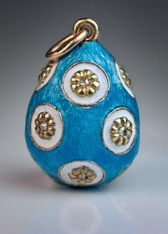 A Superb Guilloche Enamel Jewelled Egg Pendant. The egg is decorated with moulded flowers within round white opaque enamel rosettes surrounded by turquoise guilloche enamel. Each flower is set with a tiny rose cut diamond.
