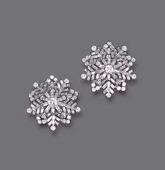 "A PAIR OF DIAMOND ""SNOWFLAKE"" EAR CLIPS, BY VAN CLEEF & ARPELS Each circular and baguette-cut diamond snowflake of openwork design, mounted in platinum, circa 1946"