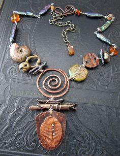 Jewelry OFF! Ancient Treasures and Fossils Necklace by Staci Louise Originals art beads by Artisan Accents by Staci Louise Funky Jewelry, Copper Jewelry, Wire Jewelry, Boho Jewelry, Jewelry Crafts, Beaded Jewelry, Jewelry Design, Jewellery, Pandora Jewelry